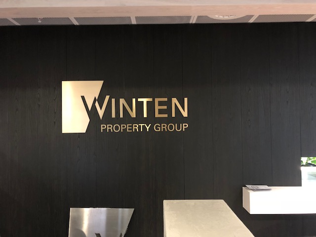 Winten Logo in gold against black timer background